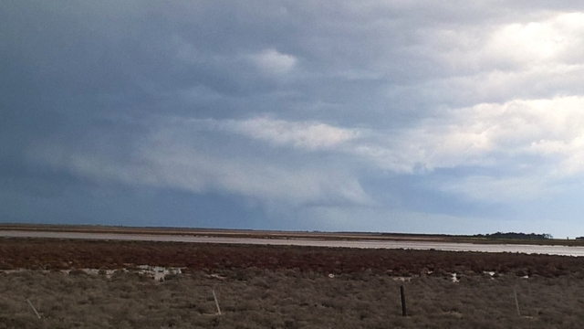 A phone grab, a very low wall cloud is apparent on the line now.