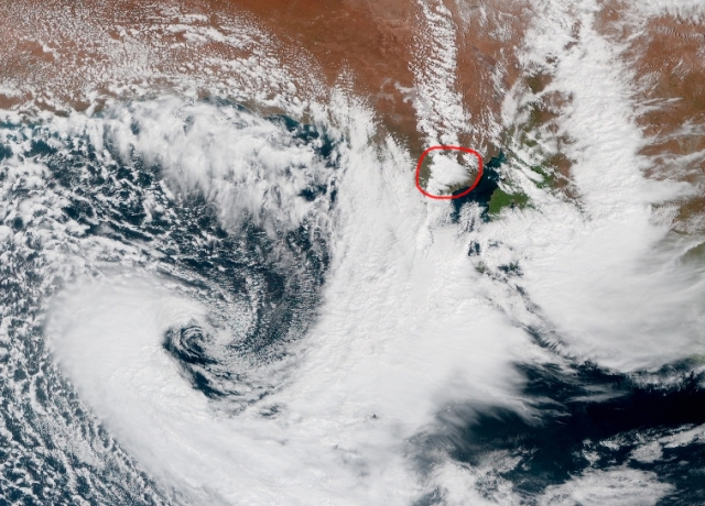 Satellite showing the developing supercell in relation to the deepening low to the west. I have circled it in red. Notice the broad area of convective rain off to the east that had developed earlier that morning.
